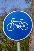 Blue bicycle bike road or path sign
