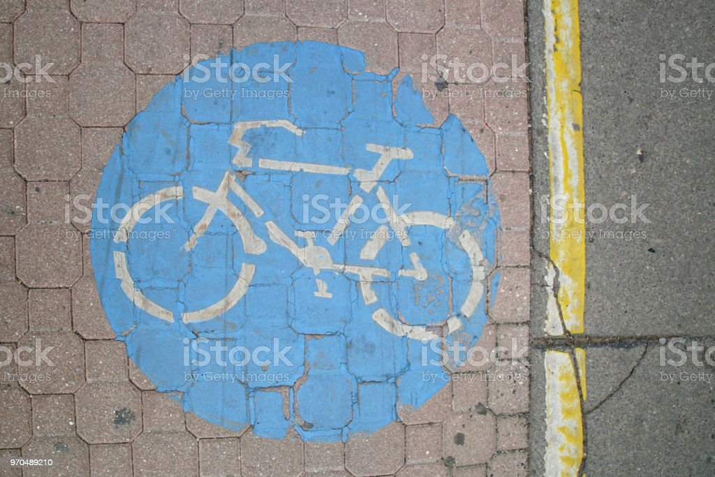 Blue bicycle sign on the floor stock photo