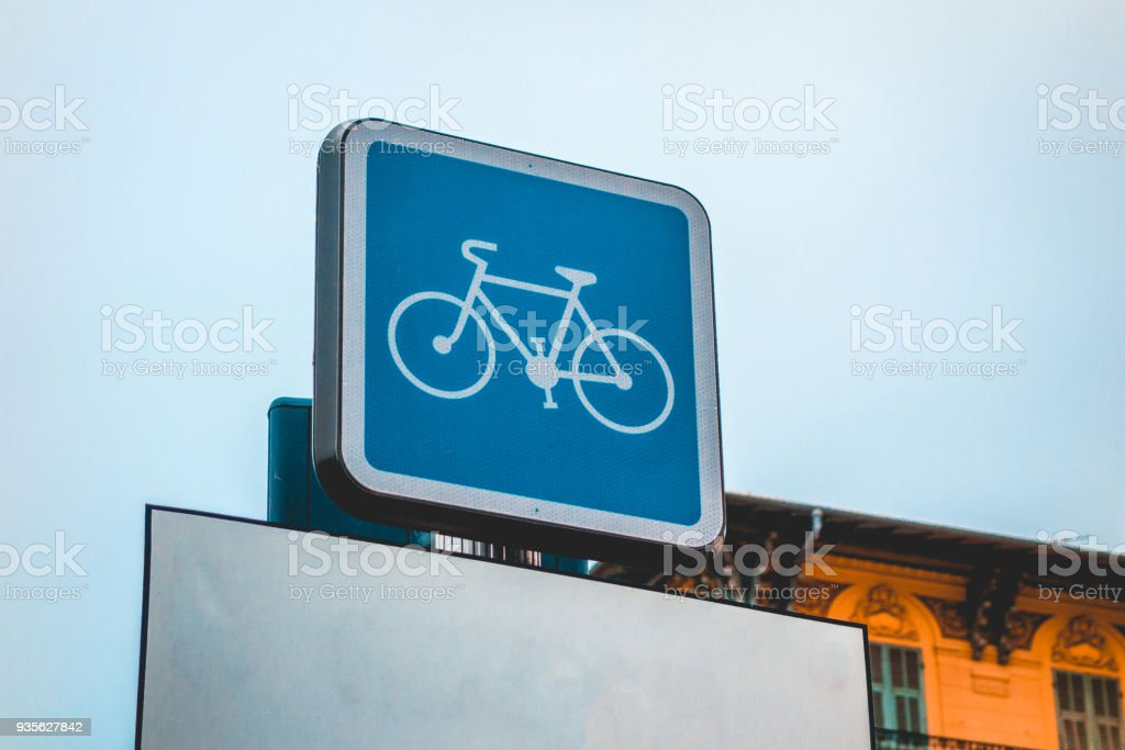 blue bicycle traffic sign on cold background stock photo