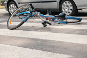 Blue bike on a pedestrian crossing after fatal incident with a car