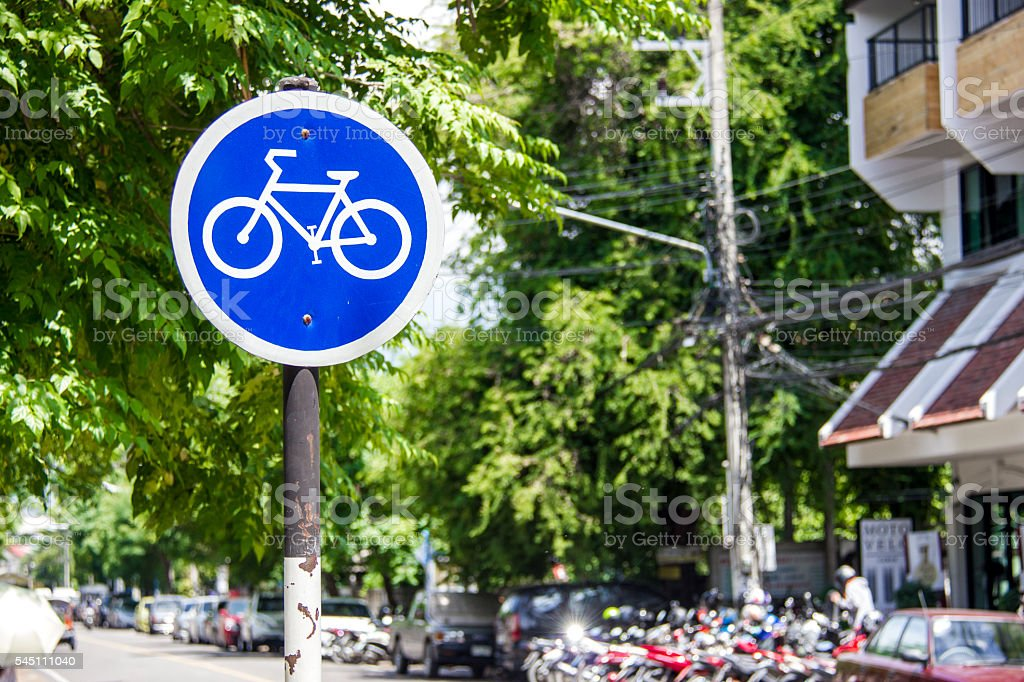 Blue bike sign, bike lane symbol in downtown city stock photo