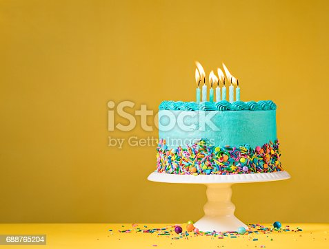 istock Blue Birthday Cake on Yellow 688765204