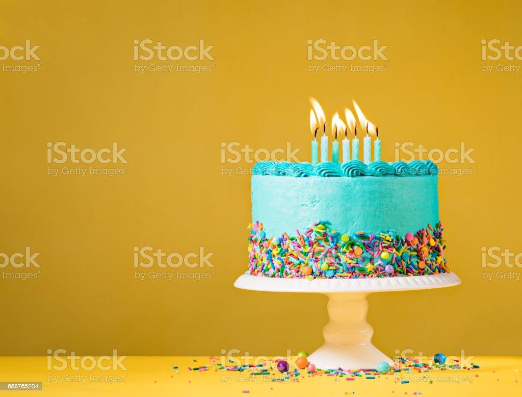 Blue Birthday Cake on Yellow stock photo