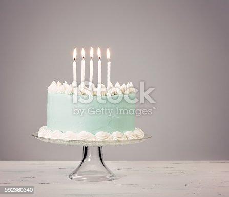 Blue Birthday Cake Over Grey Background