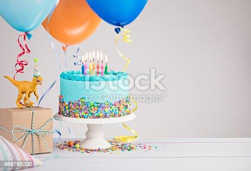 istock Blue Birthday Cake with Balloons 688765200