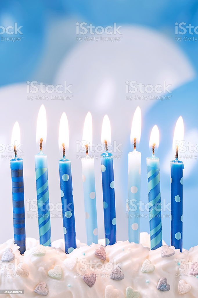 Blue birthday candles stock photo