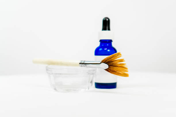 blue blank eye dropper bottle for cosmetic chemical peel formula, with dish and applicator makeup  brush, for beauty treatments, with white blank label. room for text (copy). - chemical peel stock pictures, royalty-free photos & images