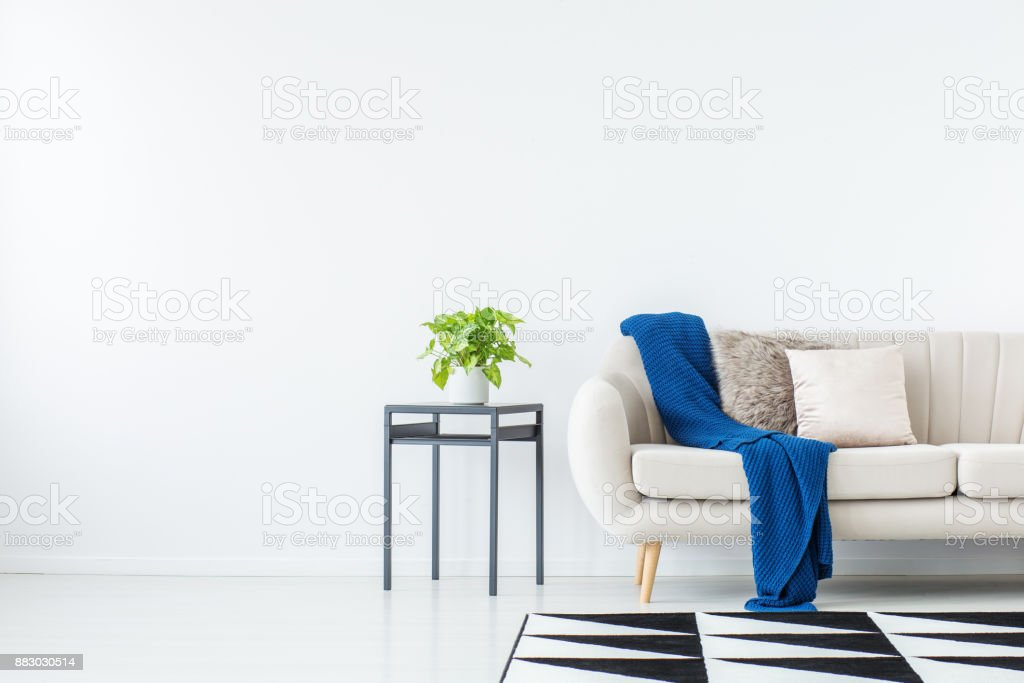 Blue blanket on beige sofa stock photo
