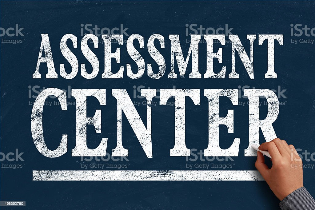 Blue board with Assessment Center written on it with chalk royalty-free stock photo