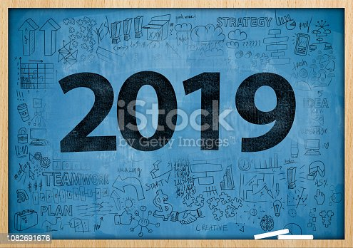 888342518istockphoto 2019 NEW YEAR / Blue board with charts and diagrams concept (Click for more) 1082691676