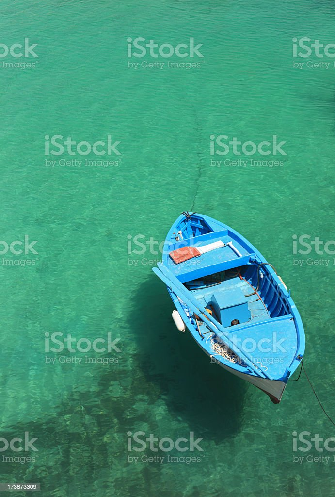 Blue boat from above in Tricase Porto, Puglia Italy royalty-free stock photo
