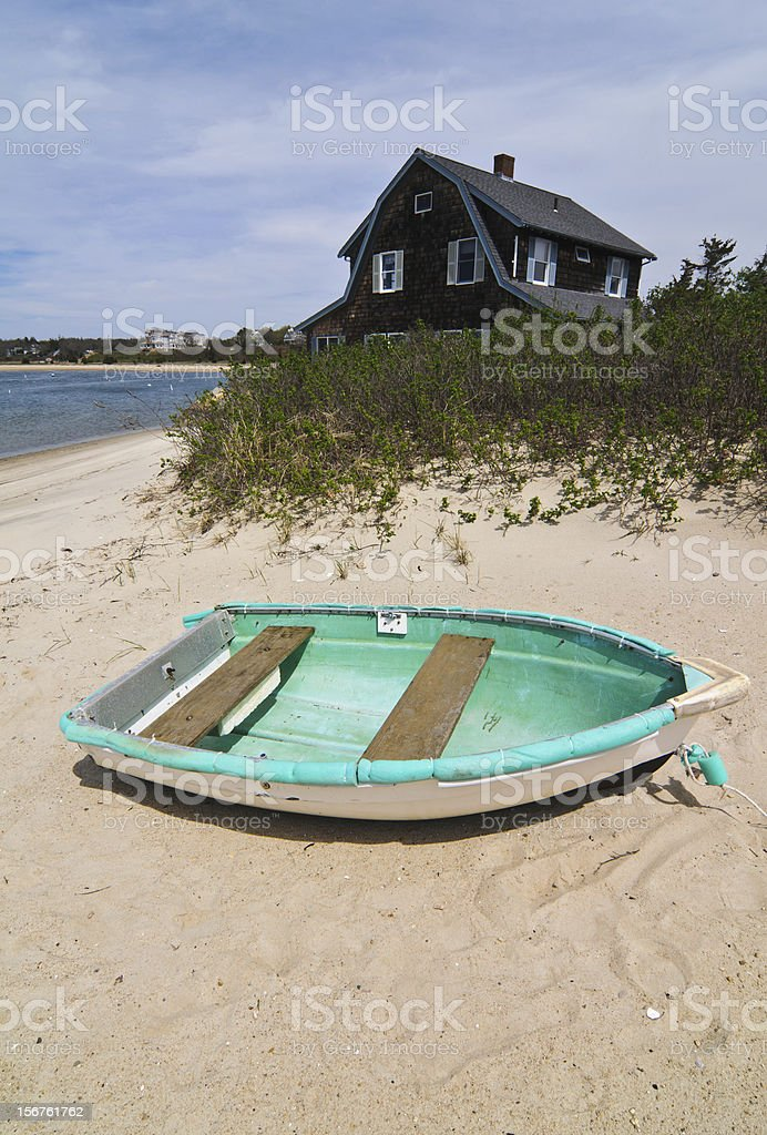 Blue Boat on the Beach stock photo