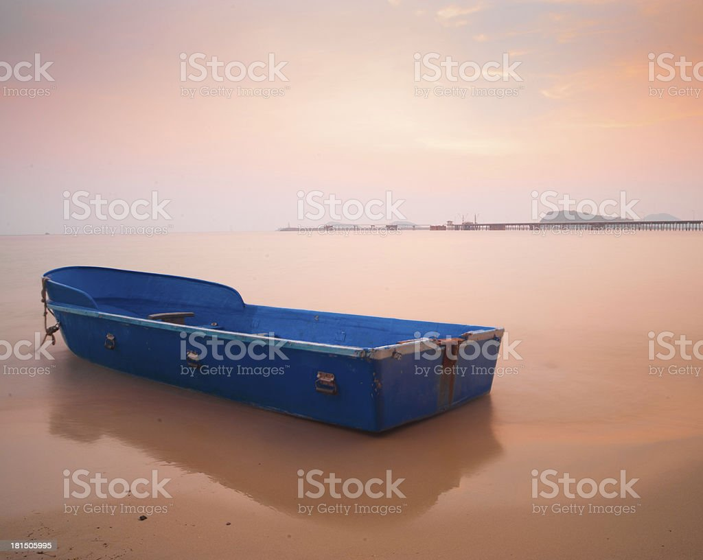 blue boat on the beach royalty-free stock photo