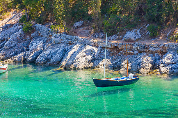 Blue boat on turquoise seawater stock photo
