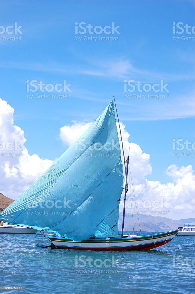 Blue boat sailing on Titicaca lake, Bolivia royalty-free stock photo