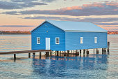 Moonrise over Crawley Edge Boatshed, a well-recognized and frequently photographed site in Perth. It is thought to have been constructed in the early 1930s and has since been refurbished.