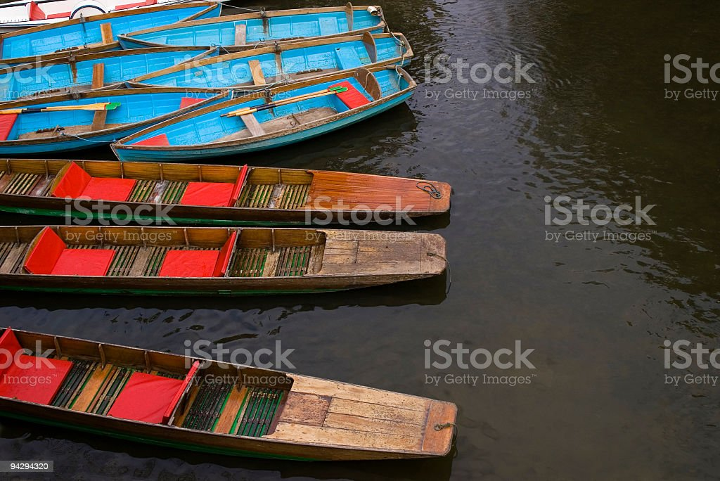 Blue boats and wooden punts stock photo