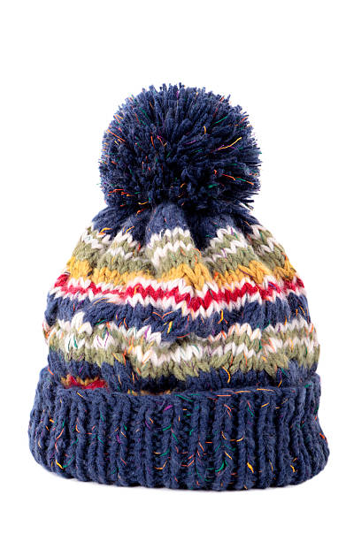 Blue bobble hat Blue bobble hat isolated against a white background. knit hat stock pictures, royalty-free photos & images