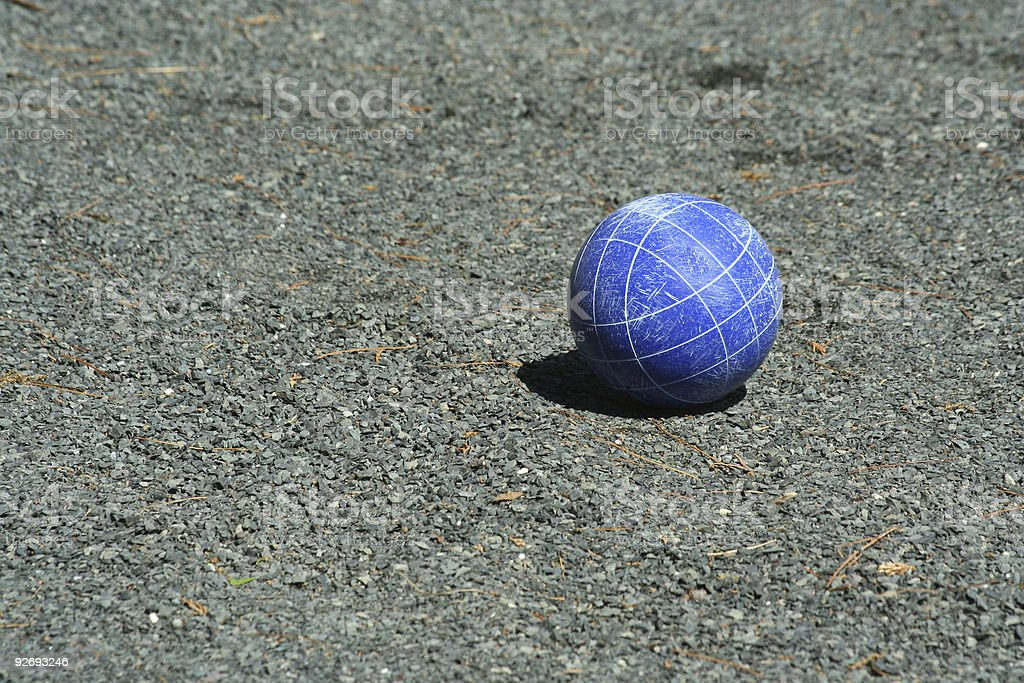 Blue bocce ball on a court stock photo