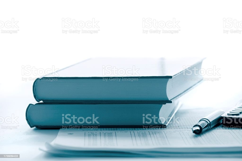 blue books , charts and a pen stock photo