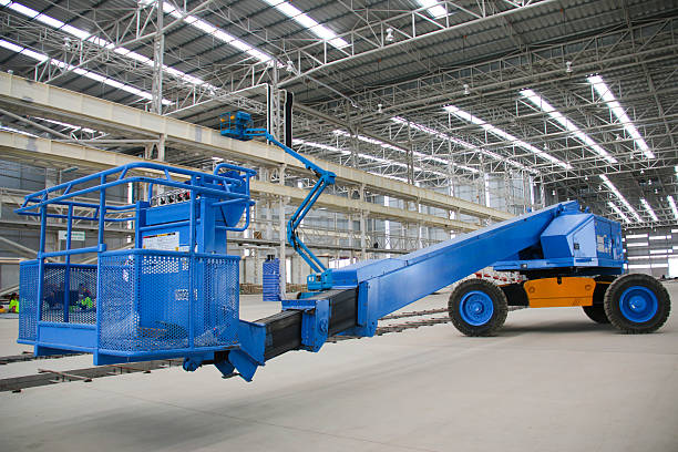 blue boom lift perspective indoor The atmosphere indoor of heavy industrial plants. mobile crane stock pictures, royalty-free photos & images