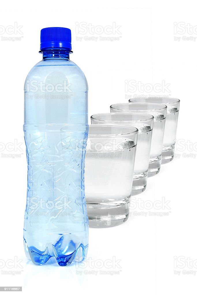 Blue bottle and glasses of water royalty-free stock photo