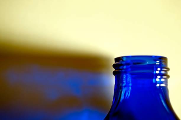Blue Bottle and Reflection stock photo
