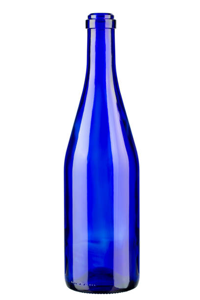 Blue bottle of wine. Vertically standing wine bottle. stock photo