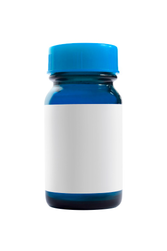 Front view of a blue bottle with blank label. Isolated on white background.
