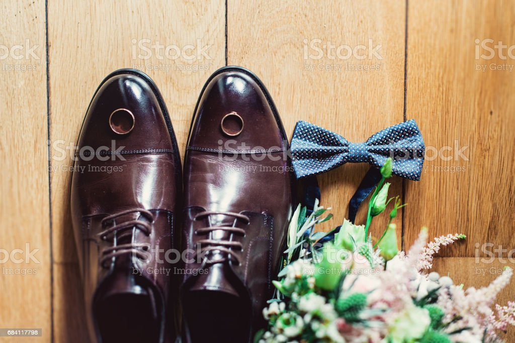blue bow tie, leather shoes and wedding rings. Grooms wedding morning. Close up of modern man accessories zbiór zdjęć royalty-free