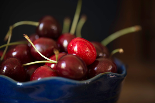 Blue Bowl Of Cherries Stock Photo - Download Image Now