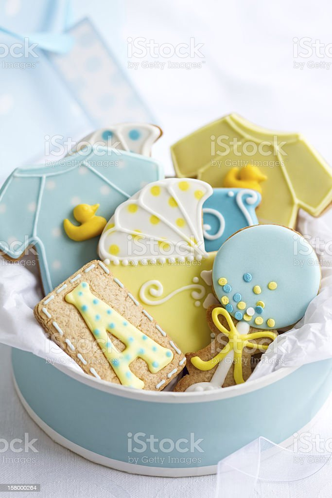Blue Bowl Of Yellow And Blue Baby Shower Cookies On White Stock