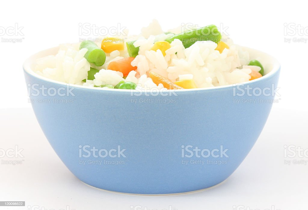 Blue bowl with cooked rice and mixed vegetable royalty-free stock photo