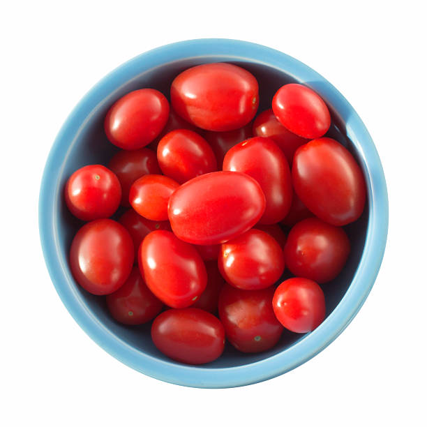 Blue bowl with small tomatoes stock photo