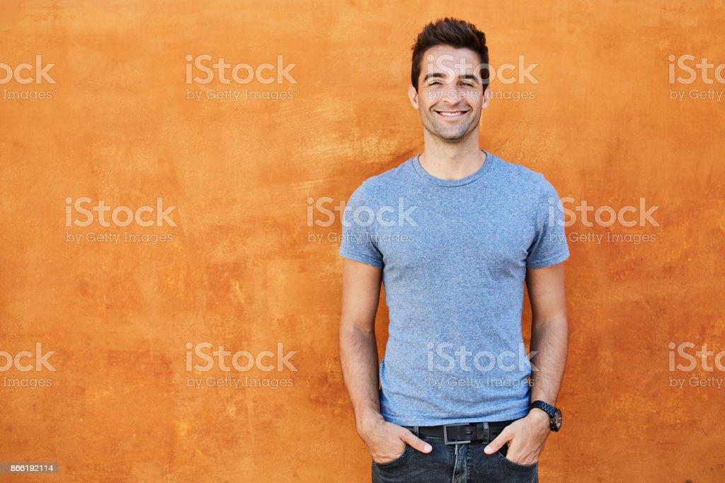 Blue boy on orange stock photo