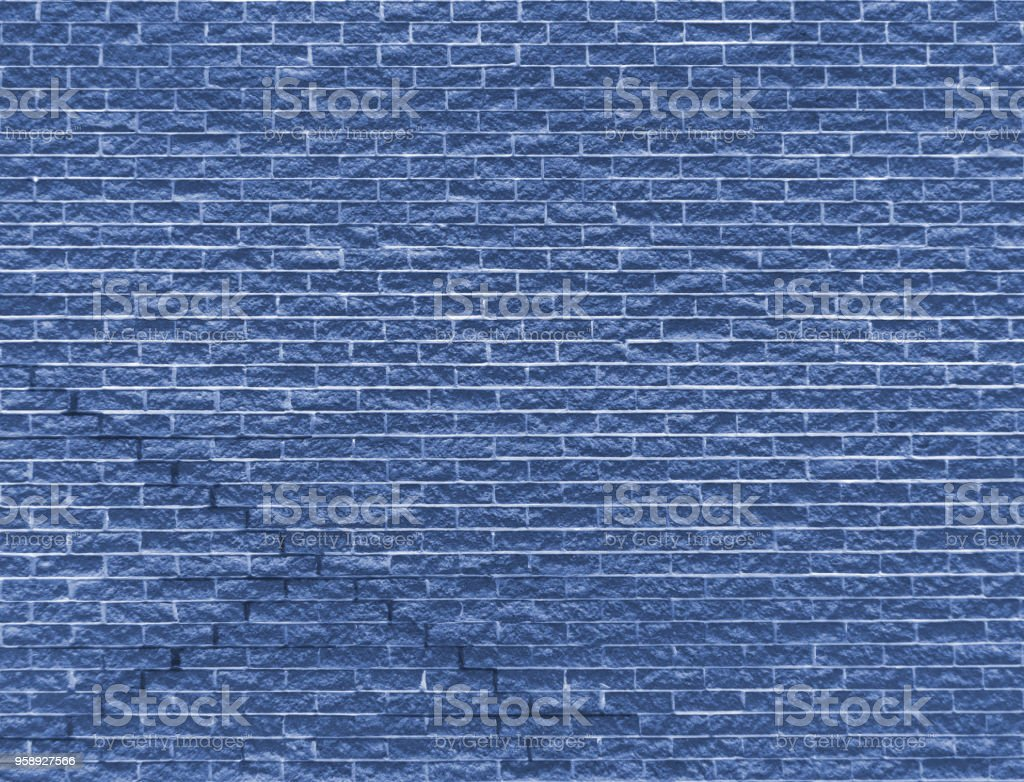 blue brick wall background image with rough texture and cracks stock photo