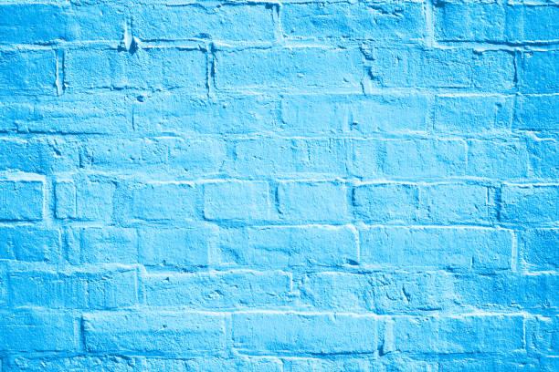 blaue ziegel wand hintergrundtextur - hellblaues zimmer stock-fotos und bilder
