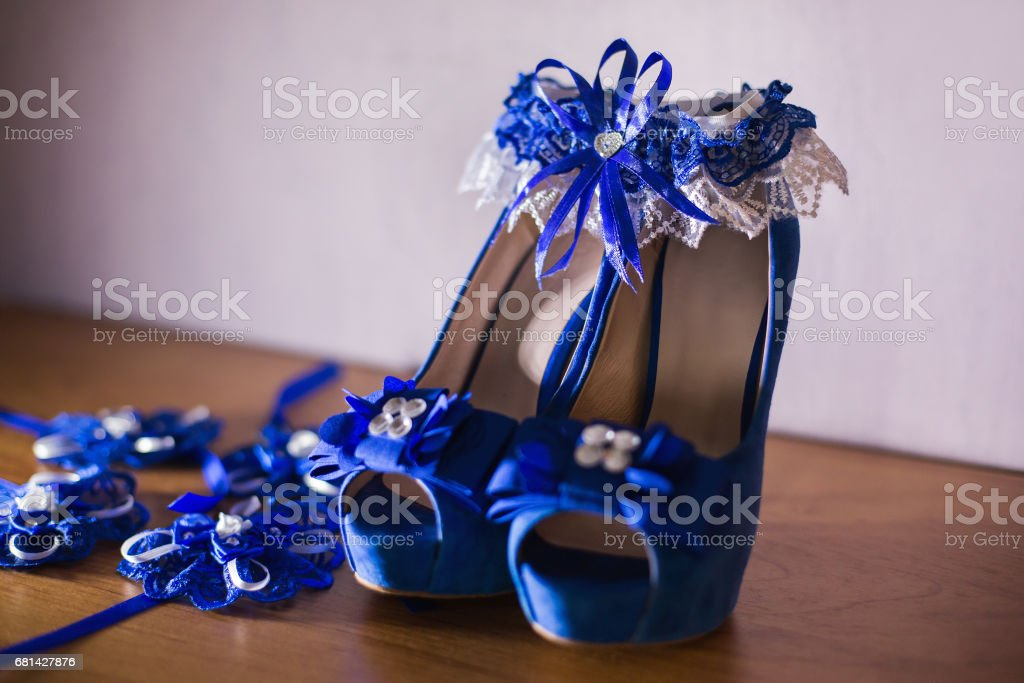 blue bridal woman shoes, blue garter stock photo
