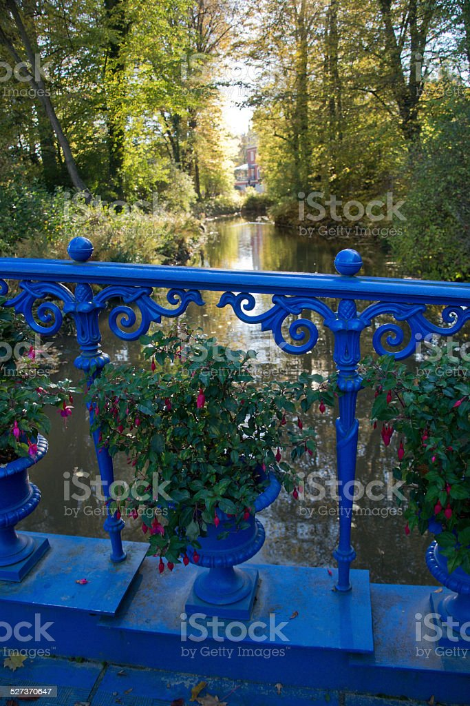 Blue bridge in the park stock photo