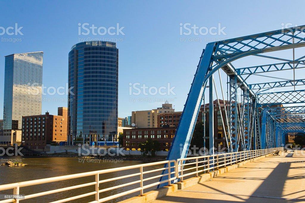 Blue Bridge walking bridge and Grand Rapids skyline stock photo