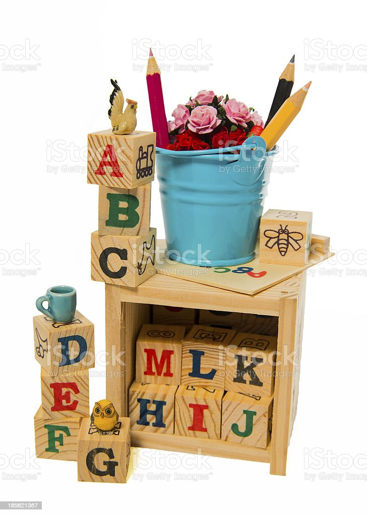 Blue bucket with color pencil on wooden alphabet block box royalty-free stock photo