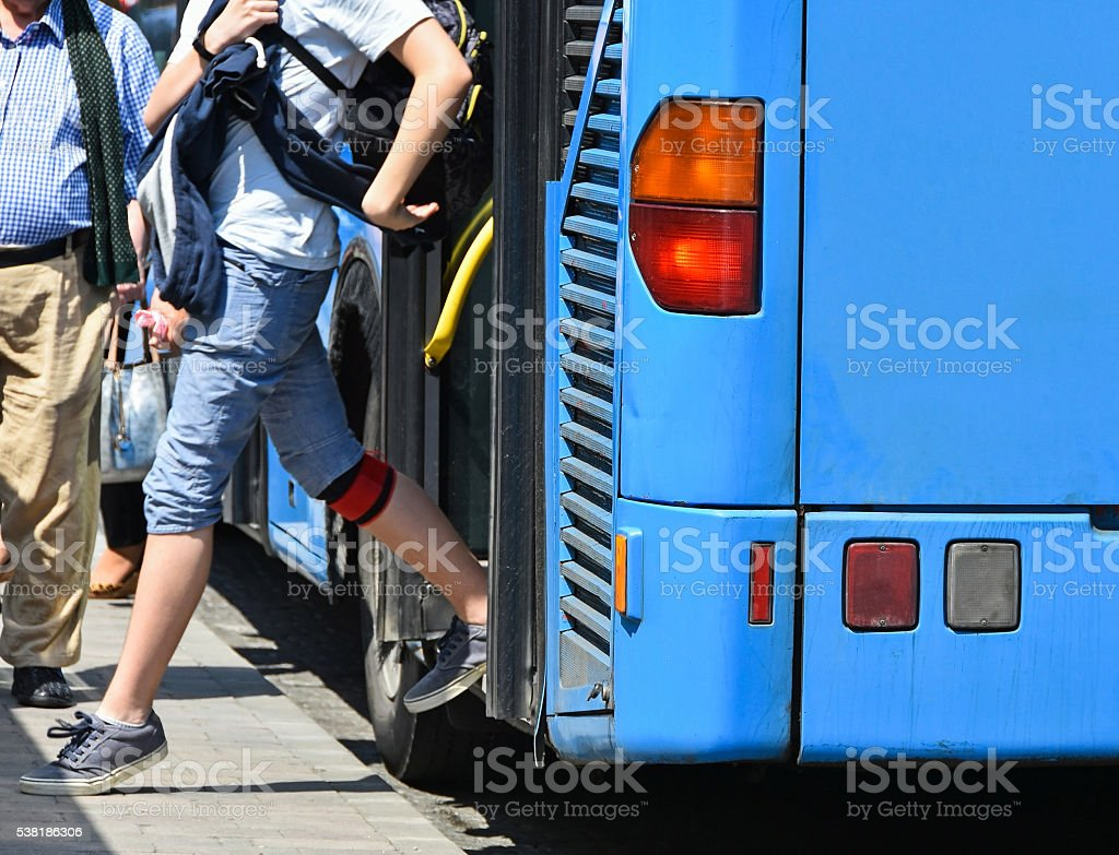 Blue bus at the stop stock photo