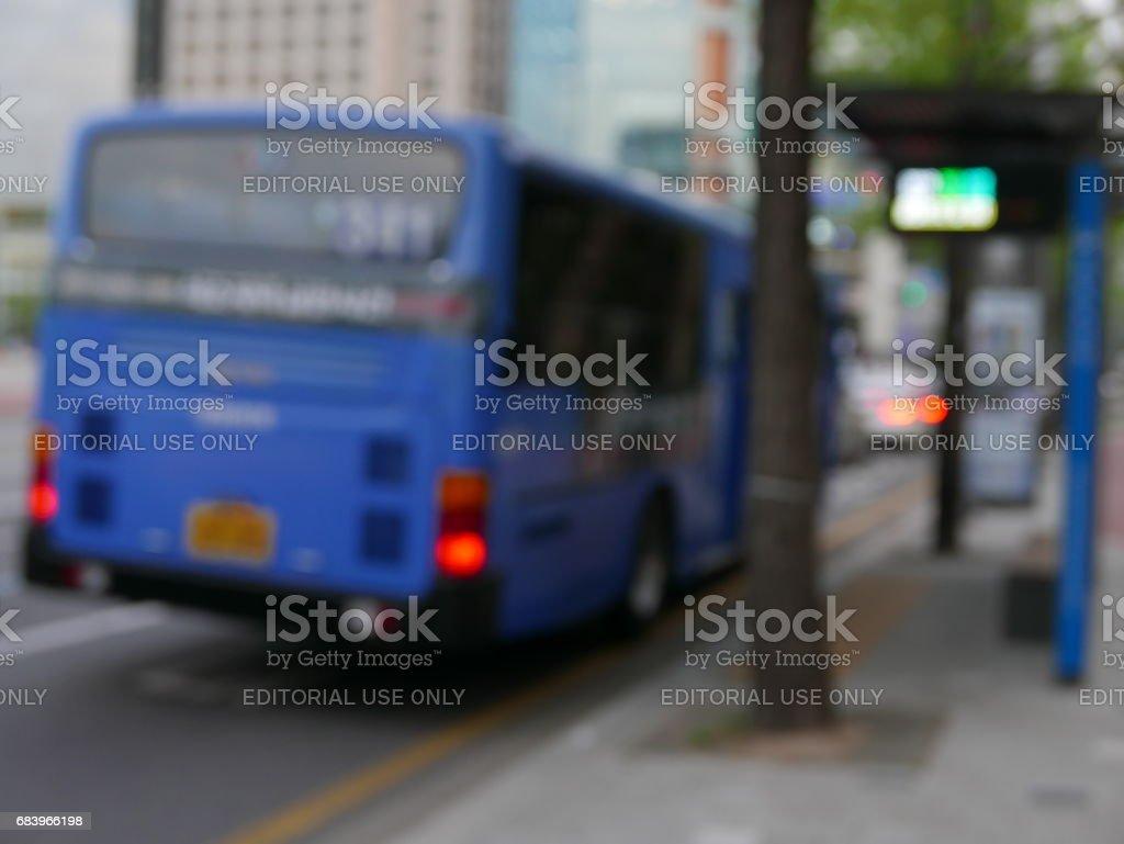 Blue bus unfocused stock photo