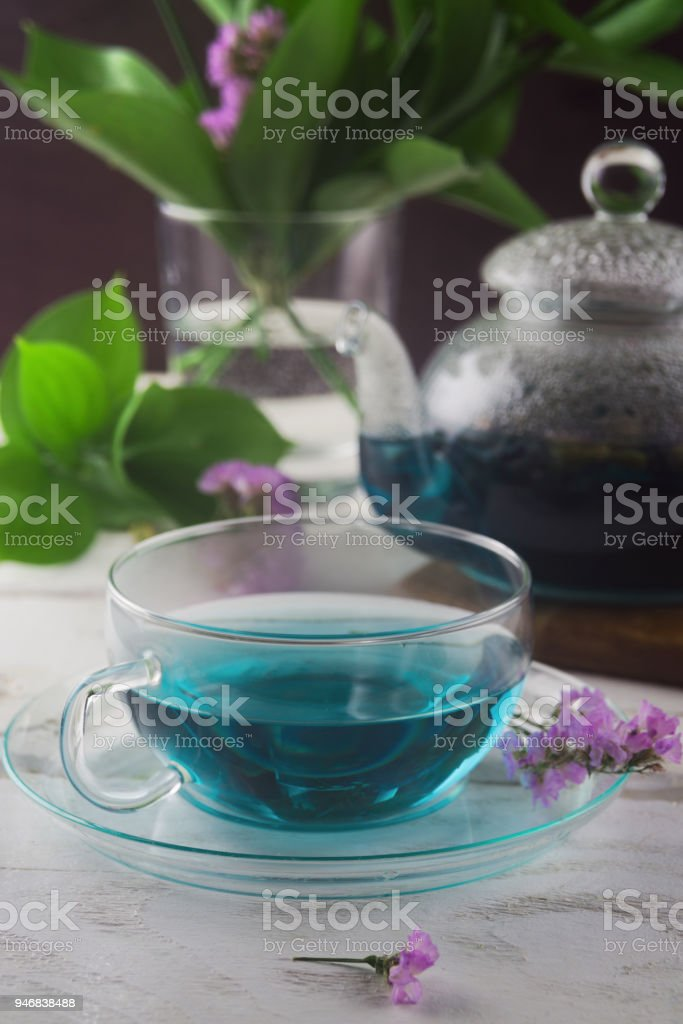 Blue Butterfly Pea tea in a glass cup and glass teapot on a table, Clitoria Ternatea tea, selective focus stock photo