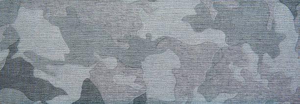 Blue camo patern texture on cloth stock photo