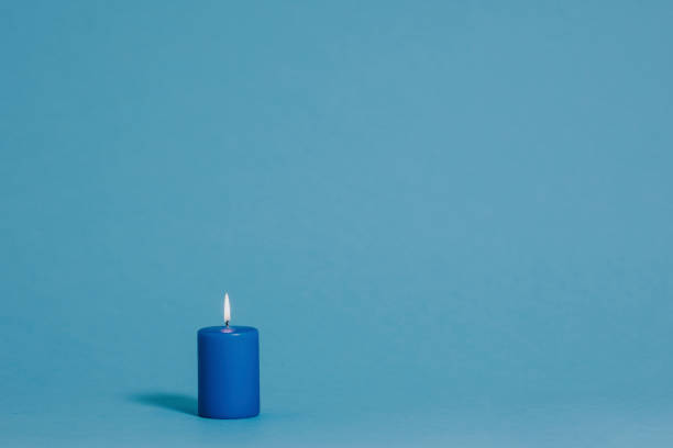 Blue candle on blue stock photo
