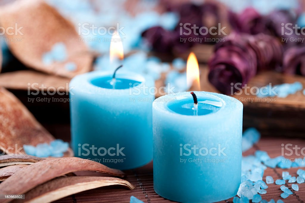 Blue candles and bath salt decoration stock photo