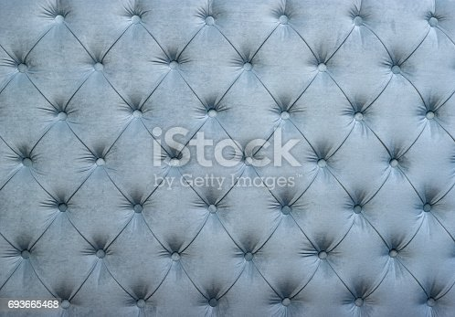 istock Blue capitone tufted fabric upholstery texture 693665468