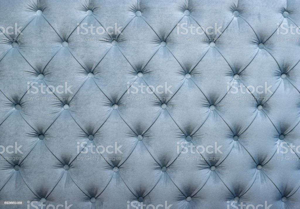 Blue capitone tufted fabric upholstery texture stock photo