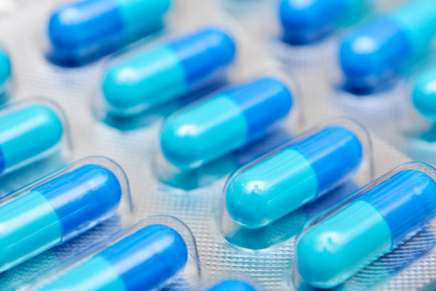 blue capsules blister packaging stock photo